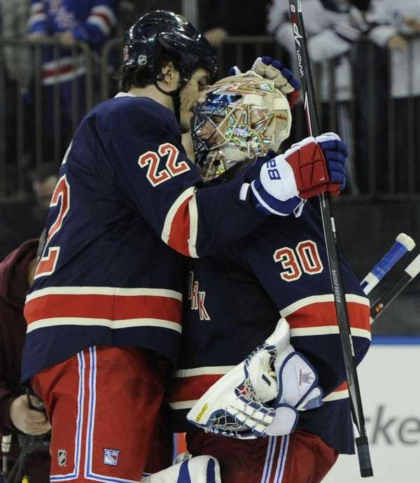 Brian Boyle congratulates goalie Henrik Lundqvist after their