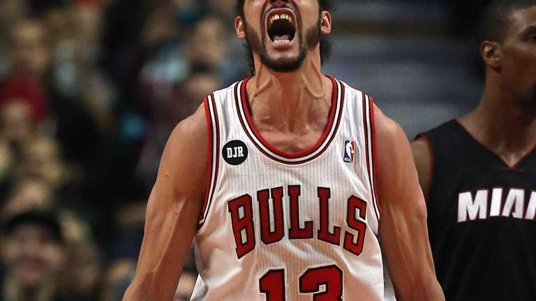 Chicago Bulls center Joakim Noah celebrates after being