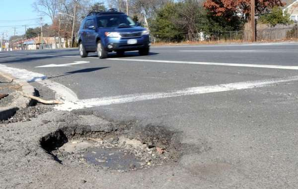 A large pothole on Waverly Avenue on Wednesday,