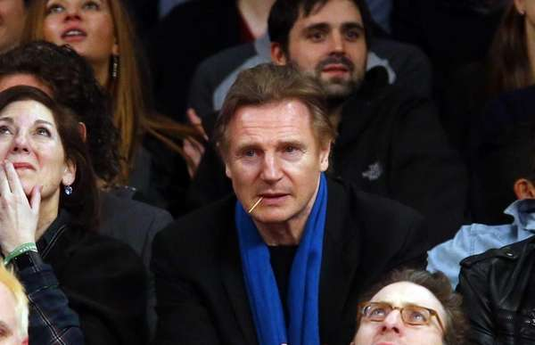 Actor Liam Neeson attends a game between the