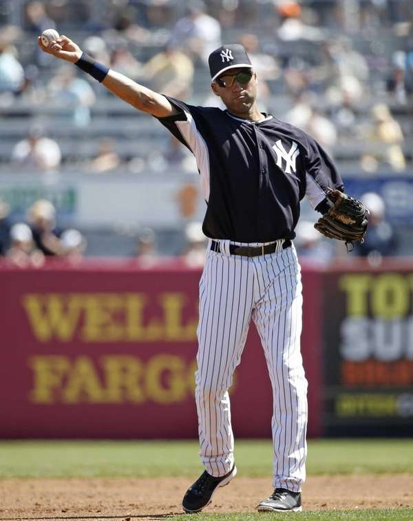 Derek Jeter throws to third baseman between innings