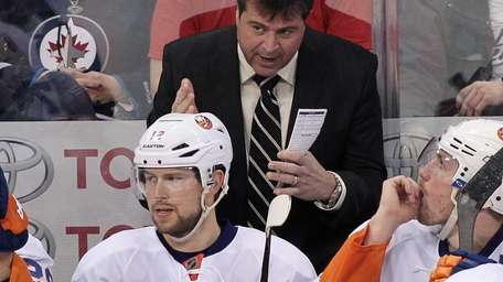 Jack Capuano gestures from the bench as he