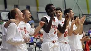 Stony Brook players cheer a point against Hartford