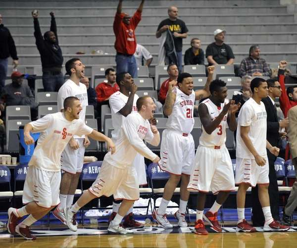 Stony Brook players celebrate a 69-64 win over