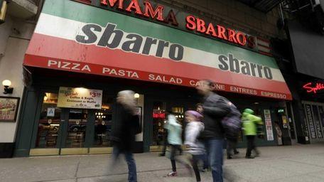 Pedestrians pass by a Sbarro restaurant in Times