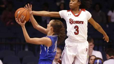 St. John's guard Aliyyah Handford (3) challenges the