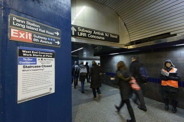 Long Island Rail Road commuters walk past the