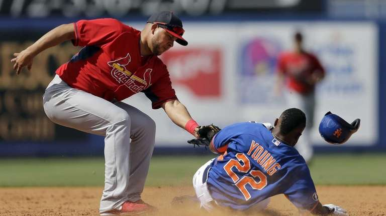 Eric Young Jr., right, is tagged out by