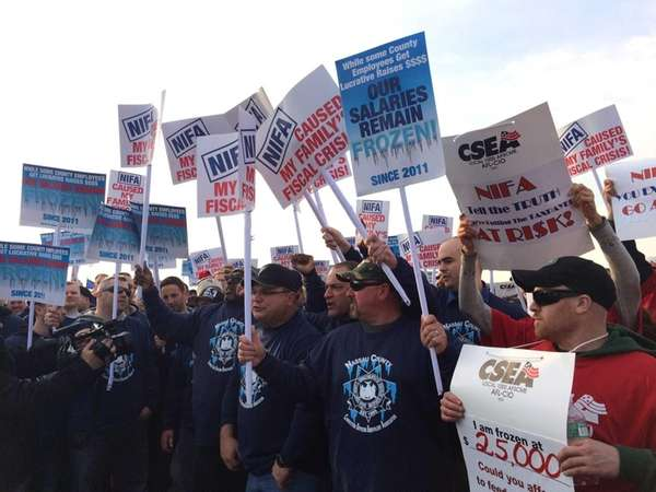 Nassau County workers rally outside the Uniondale Marriott