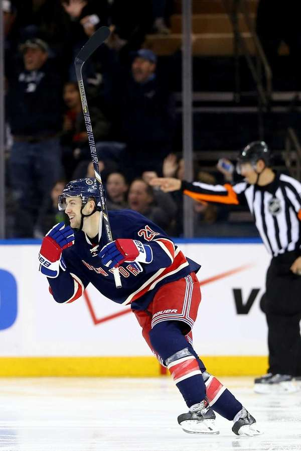 Derek Stepan celebrates his assist as Chris Kreider