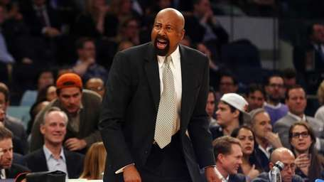Mike Woodson reacts in the first half of