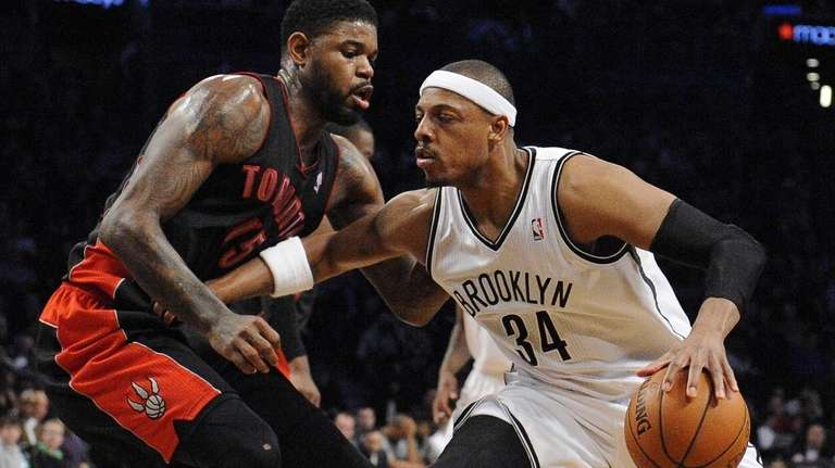 Nets forward Paul Pierce is defended by Toronto