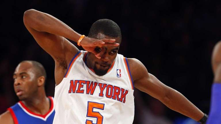 Tim Hardaway Jr. reacts after hitting a three-point