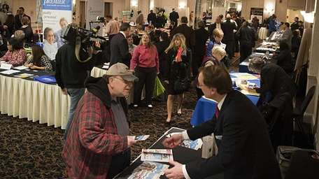 Job seekers attend Job Fair 2014 at the