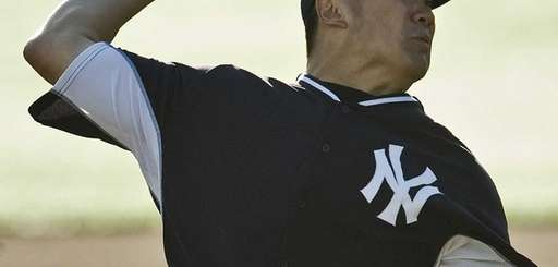 Masahiro Tanaka pitches during a simulated game Tuesday,