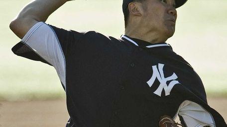 Masahiro Tanaka pitches during a simulated game Tuesday,