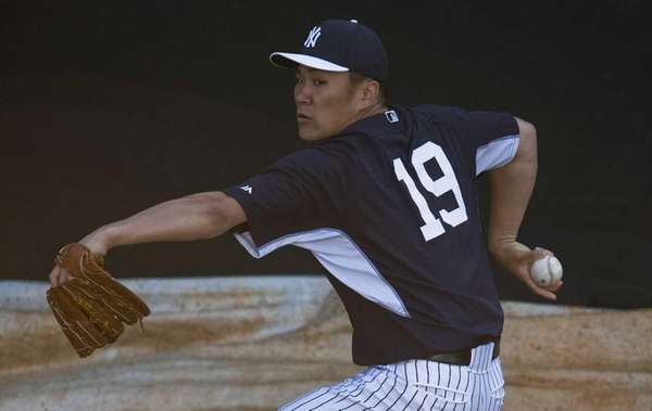 Masahiro Tanaka throws in the bullpen before pitching