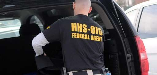 A federal agent removes evidence Tuesday, March 11,