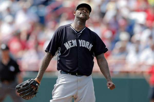CC Sabathia of theYankees reacts to a base