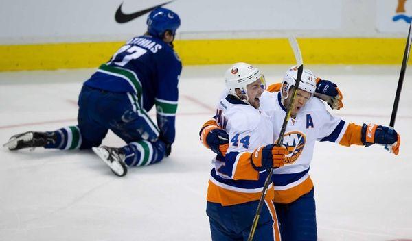 Islanders' Calvin de Haan and Kyle Okposo celebrate