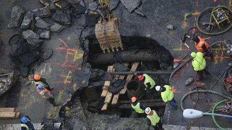 Crews work on a broken water main on