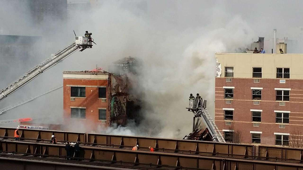 Firefighters battle a blaze at the site of