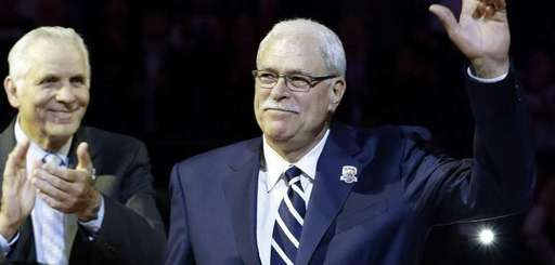 Phil Jackson waves to the crowd as former