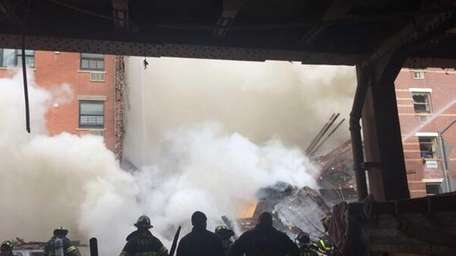 Firefighters at the scene of an explosion and
