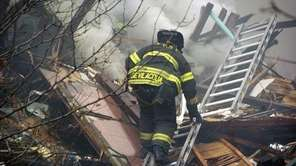 An FDNY firefighter searches for survivors at the