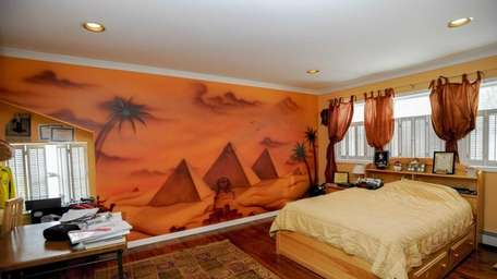 This Melville home includes several floor-to-ceiling-size murals of