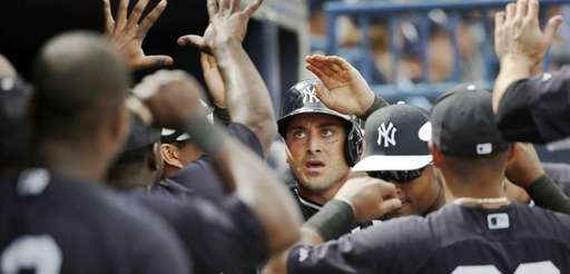 Teammates greet Yankees' Francisco Cervelli after he hit