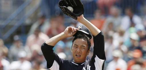 Yankees starting pitcher Hiroki Kuroda removes his cap