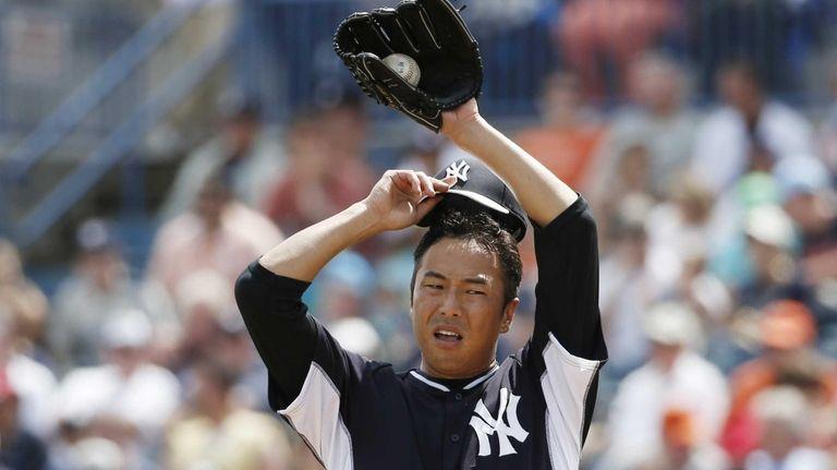 Yankees starting pitcher Hiroki Kuroda removes his cap