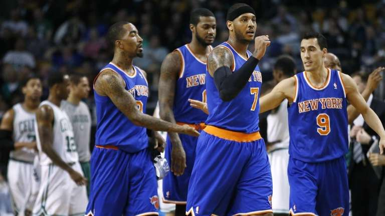 Carmelo Anthony makes a fist as he leads