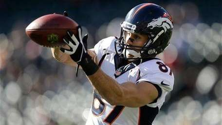 Denver Broncos wide receiver Eric Decker (87) warms