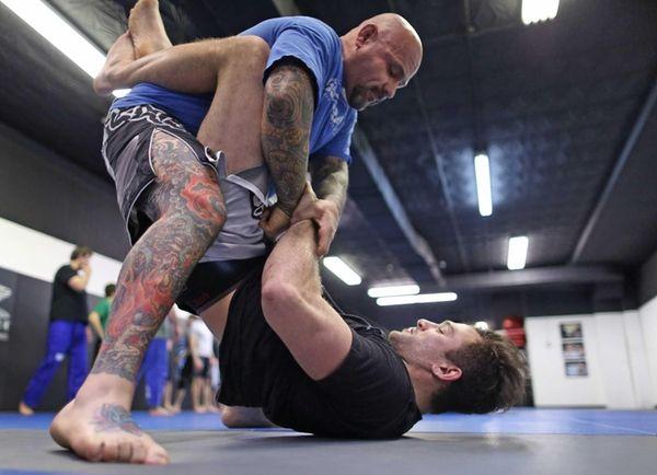 Gian Villante, at bottom, practices jiu-jitsu with William