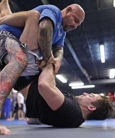 Gian Villante, at bottom, practices jiu-jitsu with William