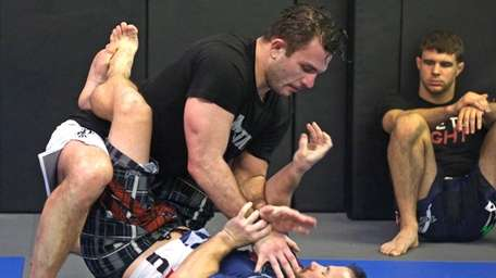 Gian Villante, on top, spars with Chris Mead