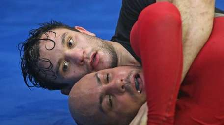 Gian Villante, background, trains with Gabriel Toribio as