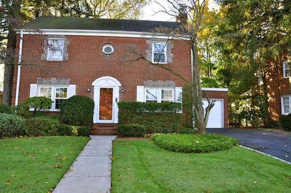At 2,026 square feet, this center-hall brick Colonial