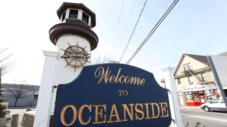 A Welcome to Oceanside sign and the Liberty