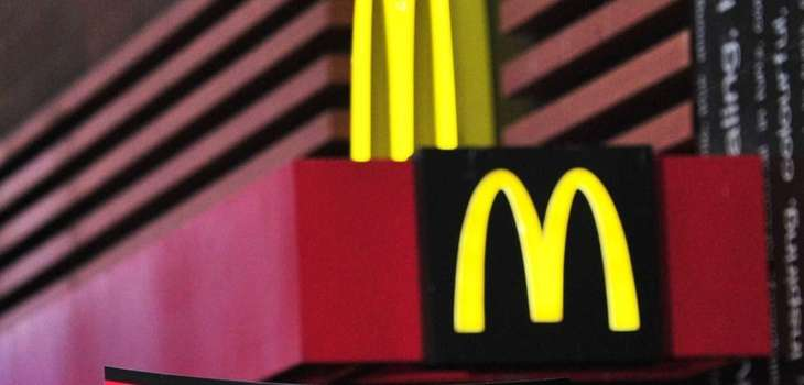 (FILES) Demonstrators march outside a McDonald's restaurant near