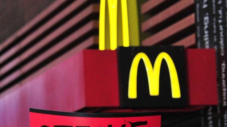 (FILES) Demonstrators march outside a McDonald's restaurant near