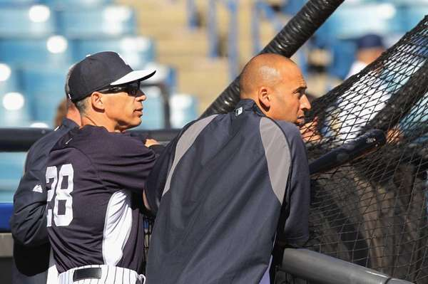 Joe Girardi and Derek Jeter watch batting practice