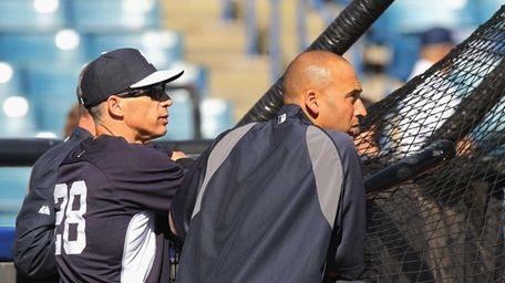 Joe Girardi and Derek Jeter watch batting practice