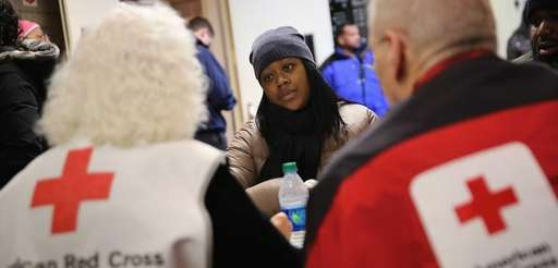 Aisha Watts applies for assistance at an American