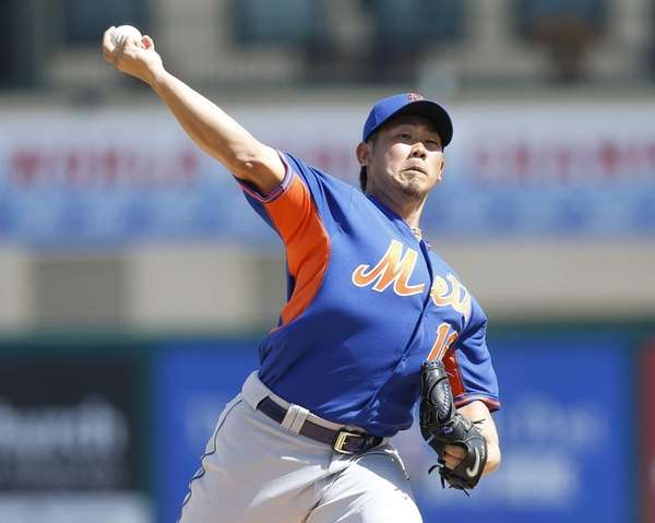 Daisuke Matsuzaka throws the ball against the St