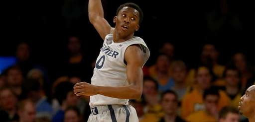 Semaj Christon of the Xavier Musketeers grabs the