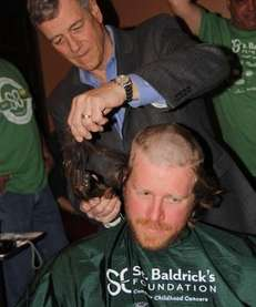 Joseph Incalcatera, 65, of Islip, cuts the hair