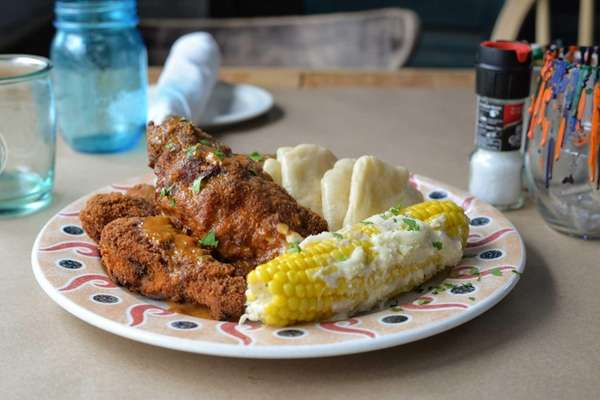 Crisp and juicy buttermilk fried chicken is served